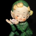 Vintage Lefton Pixie Boy Holding Flower